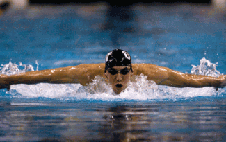 The World famous Michael Phelps shows good form in this picture. Chin on the water to breathe, arms carried laterally over the water with little finger on the top and thumb just brushing the surface.